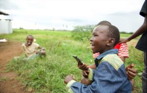 Boy holds phone